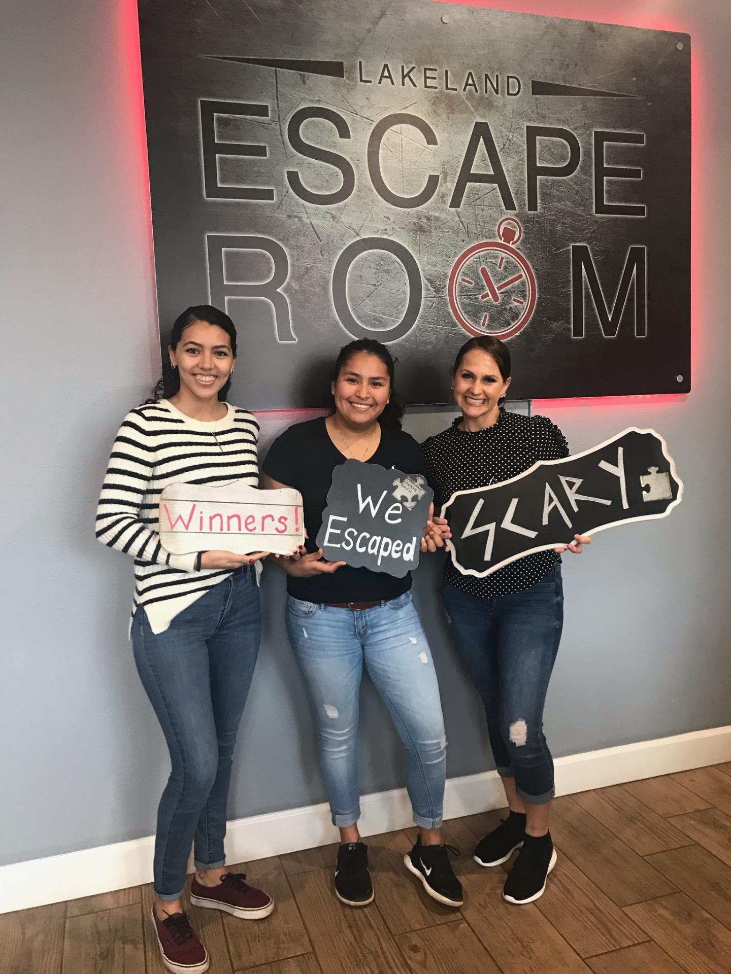 "Gaby, Brisa and Dr. Bucci successfully escaped the ""Insane Asylum"" at the Lakeland Escape Room - 2018 Bucci Eye Care Christmas Party"