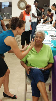 Lucille Anderson gets her eye pressure checked by Dr. Bucci at the   Highlands County NAACP Youth Council Health Fair 2017